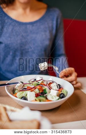 Healthy Eating, Dieting And People Concept - Close Up Of Young Woman Eating Vegetable Greek Salad At