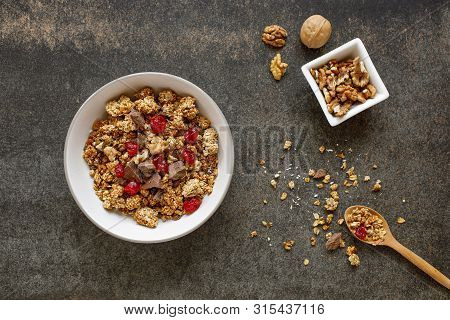 Two Wooden Bowls Of Granola On White Marble Table