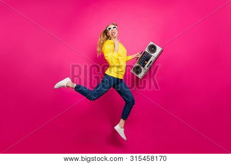 Full Size Photo Of Cool Lady Jumping High Funky Rocker Dj Wear Casual Outfit Isolated Pink Backgroun