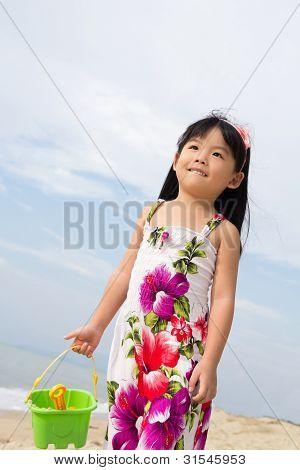 Portrait Of Little Girl On Beach
