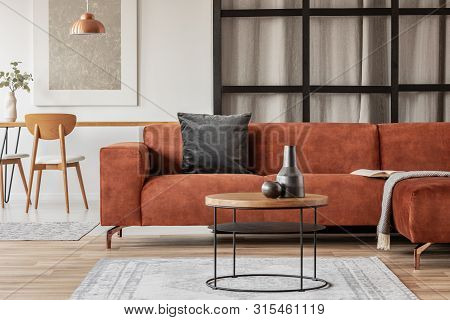 Stylish Corner Sofa With Black Pillow In Open Space Studio Apartment