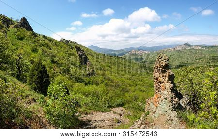Mountain Landscape With Rock Outliers Volcanic Origin Among Forest On A Foreground And Mountain Rang