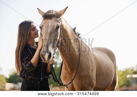 Tenderness, Animals And Friendship Concept. Pretty Female Jockey, Female Vet Adore Horses, Petting G