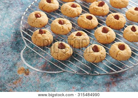 Fresh Baked Almond Cookies On Stainless Steel Grille, Rustic Background