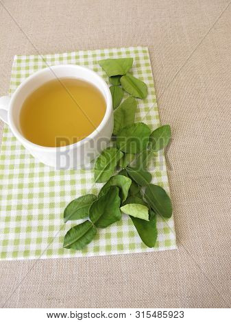 Cup Of Tea With Dried Kaffir Lime Leaves