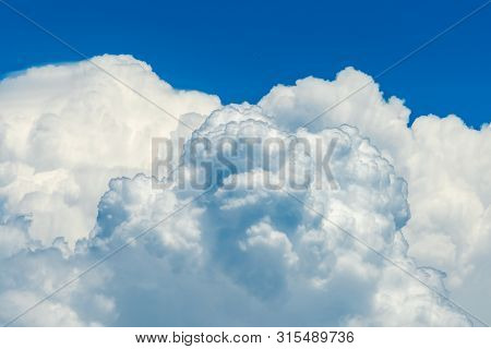 Beautiful Blue Sky And White Cumulus Clouds Abstract Background. Cloudscape Background.  Blue Sky An