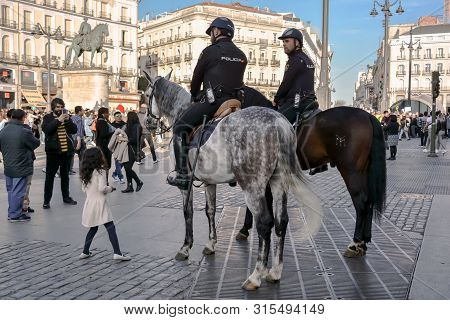 Madrid, Spain-24 February 2019: Police On Horses Are Watching And Helping People En The Square