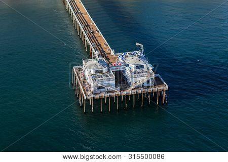 Malibu, California, USA - December 17, 2016:  Aerial view of historic Malibu Pier on the pacific coast near Los Angeles, California.