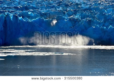 Ice Calving From The Glacier At The Tracy Arm Fjord In Southern Alaska.