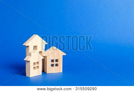 Three Residential Buildings Figurine. The Concept Of Buying And Selling Real Estate, Renting. Search