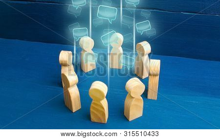 Speech Clouds In The Center Of A People Circle. Discussion Processes In A Team Or Community. Share O