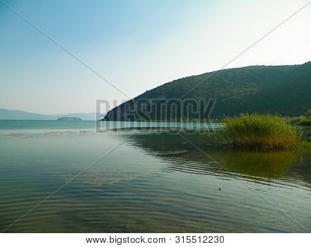 Coast of Lake Prespa and Mountains of Galicica National Park. Prespa is situated between Macedonia, Greece and Albania, known of it's wild nature and pelican reserve. poster