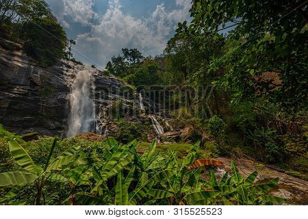 Wachirathan Waterfall Surrounded By Lush Tropical Forest In Doi Inthanon National Park Near Chiang M