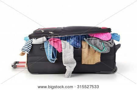 Open Suitcase With Clothing Isolated On A White