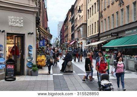 Stockholm, Sweden - August 24, 2018: People Visit Drottninggatan Shopping Street In Norrmalm Distric