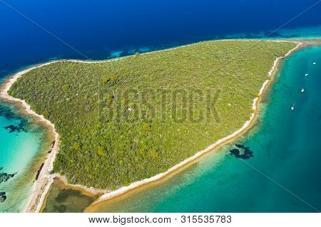 Beautiful Exotic Shaped Islands In Turquoise Sea, Clear Blue Water On The Island Of Dugi Otok In Cro
