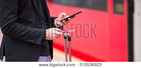 Closeup Smartphone In Male Hands Inside In Station. Casual Young Businessman Wearing Suit Jacket. Yo