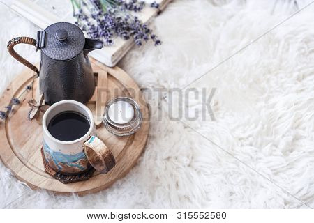 Cozy Still Life With A Kettle And A Cup Of Hot Drink