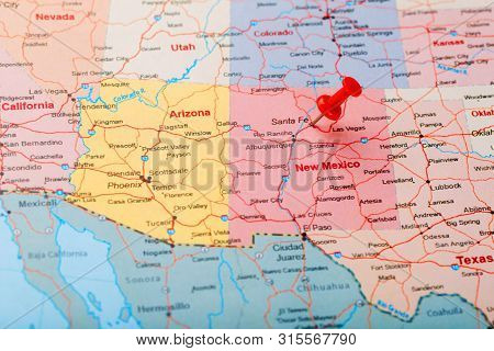Red Clerical Needle On A Map Of Usa, New Mexico And The Capital Of Santa Fe. Close Up Map Of New Mex