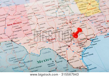 Red Clerical Needle On A Map Of Usa, Texas And The Capital Austin. Closeup Map Texas With Red Tack