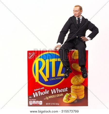 AUG 3 2019: Caricature of Russian president Vladimir Putin atop a box of Ritz crackers illustrating the joke