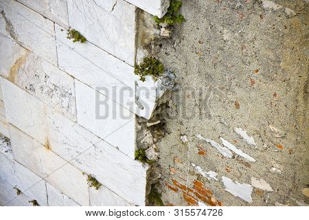 Stone slab detached due to infiltration of water - image with copy space poster