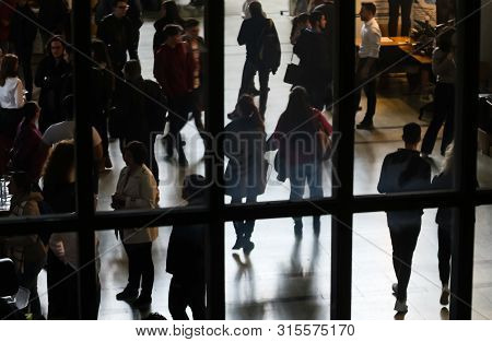 Bucharest, Romania - Novemder 07, 2018: The Silhouettes Of Students Are Seen Through A Window At A J