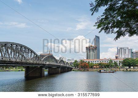 Hue, Vietnam - June 2019: Panoramic View Over City Center And Iron Bridge Over Perfume River