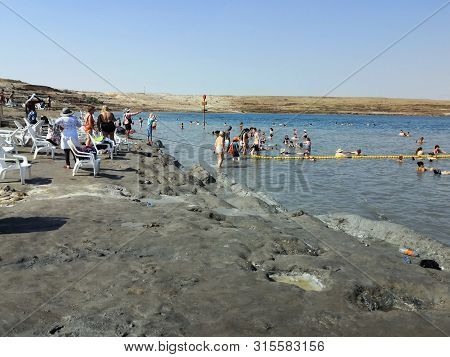 Dead Sea, Israel - June 22, 2019 : Tourists At Dead Sea, Israel. Dead Sea Has 422 Metres Below Sea L