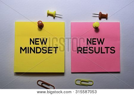 New Mindset - New Results Text On Sticky Notes Isolated On Office Desk