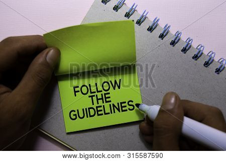 Follow The Guidelines Text On Sticky Notes Isolated On Office Desk
