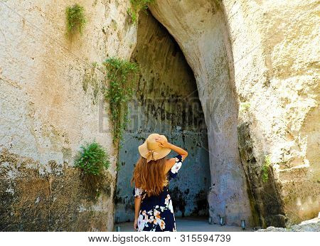 Back View Of Beautiful Woman Comes Into The Ear Of Dionysius (orecchio Di Dionisio) In Syracuse, Sic