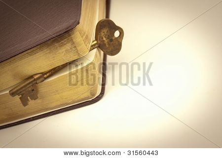 Golden Key In Book Page