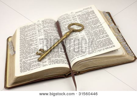 Opened Bible With Golden Key