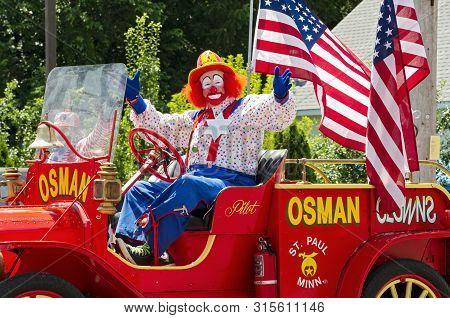 Mendota, Mn/usa -july 13, 2019: St. Paul Osman Shrine Circus Clown Gestures To Crowd From Motorcade