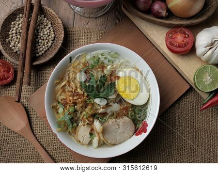Indonesian Chicken Soto Or Soto Ayam, Served With Ketupat Or Lontong