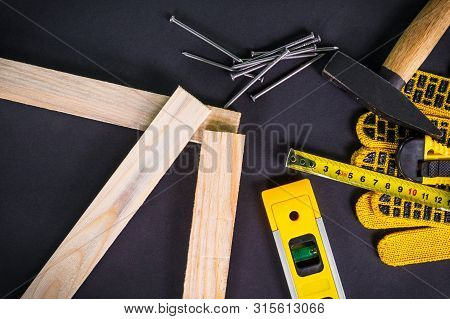 Professional tools for the joiner and spare parts.. Set for the master on black background. poster