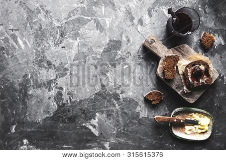 Bread With Butter And Jam In Vintage Style On A Dark Background