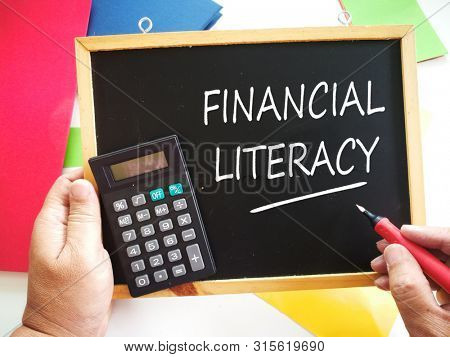 Financial Literacy word written on blackboard