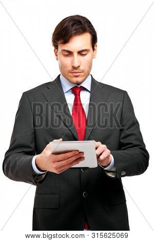Businessman using a tablet isolated on white