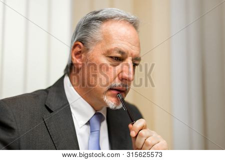 Skeptical businessman in his office