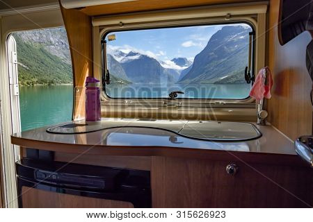 View from the window of the motorhome RV Caravan on the beautiful nature of Norway. lovatnet lake Lodal valley.