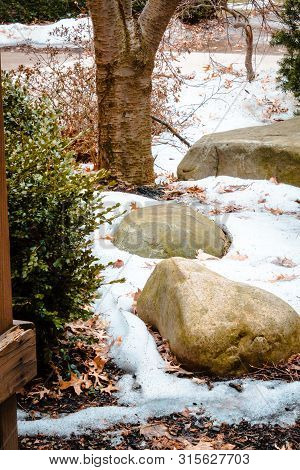 Stones In The Snow Behind A Dorm On Iup Campus
