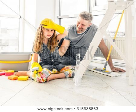 Preschool cute girl help her dad to do cleaning chores at home