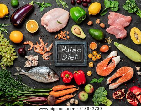 Paleo Diet Concept. Raw Ingredients For Paleo Diet - Fish, Seafood, Poultry Meat, Vegetables And Fru