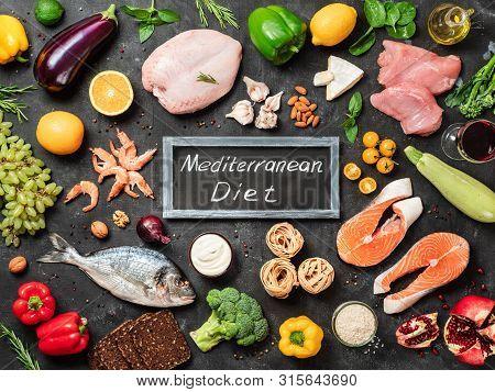 Mediterranean Diet Concept. Top View Of Food Ingredients And Chalkboard With Words Mediterranean Die