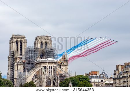Paris, France - July 14 2019: Bastille Day Aircrafts Parade Over Notre Dame De Paris - This Is The F