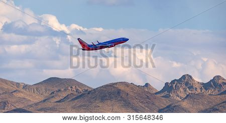 Las Vegas, Nevada, Usa - May 6, 2013: Southwest Airlines Boeing 737 Climbing Over The Mountains On D
