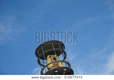 Geodetic Total Station Theodolite In Work On Sky Backround. It Is A Geodetic Tool For Measuring Dist