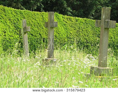 Church Yard With Three Cross Standing Tall In Long Grass